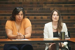 OUTLOOK PHOTO: JOSH KULLA - Rosewood Initiative Director of Community Safety Mariel Mota listens as Multnomah County Deputy District Attorney Mary Ryan speak at a recent meeting at the Rockwood Public Safety Facility.