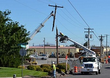 PHOTO COURTESY OF BENDBROADBAND - A semi truck hit a power pole in Bend early Monday morning, severing a critical Internet fiber that serves much of the Central Oregon area. Repairs took until 4:30 p.m