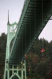 TRIBUNE PHOTO: JONATHAN HOUSE  - Greenpeace activists rappel down the St. Johns Bridge to join the protest against Shell Oil.  ,