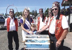 PHOTO BY MARIE EASTER - Miss High Desert Katie Noyed and High Desert Princess Alexandria Cox, center, draw the winning ticket, surrounded by Shriners Dick Sewell, left, John Pinckney, Jim McNamara and Larry Easter.