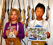 RITA A. LEONARD - Trackers Earth students Kat, 10, and Alex, 12, display the first mini-comic given free to them - and to all of Trackers student campers.