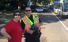 SUBMITTED PHOTO - Patti Waitman-Ingebretsen and Portland Police Officer Dan Spiegel monitor traffic in Multnomah Village during a June 30 safety vigil.