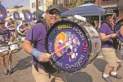 CONNECTION PHOTO: VERN UYETAKE - Elton Aguilar of 'The Beat Goes On' marching band delights the crowd at Multnomah Days last year.