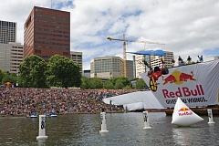 COURTESY PHOTOS: RED BULL - Members of Team Yakima celebrate their 2008 Red Bull Flugtag Portland title, having pushed and flown their Big Wheel craft the longest distance. Yakima will sport another team this year - and fly a birthday cake.