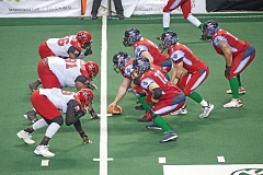 TRIBUNE PHOTO: DIEGO G. DIAZ - Jake McDonough (9) lines up to the right of Portland Thunder center John Collins as Kyle Rowley calls signals, with Sam Longo (73) also prepared to block and John Martinez in the backfield as the fullback.