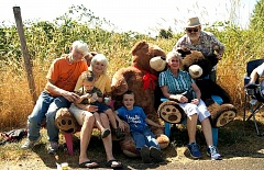 ANGELICA TRUE - A group of folks and kids gather with Karen Graves' bears on Wednesday's StoryWalk