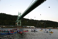 TRIBUNE PHOTO: JONATHAN HOUSE  - Greenpeace protesters dangle from the St. Johns Bridge Wednesday morning as 'kayaktivists' patrol the waters to fend off a Shell Oil icebreaker bound for the Arctic.
