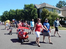BARBARA SHERMAN - Lots of kids were on wheels in the Edgewater Fourth of July parade, whether they moved under their own power or were pulled by parents or grandparents.