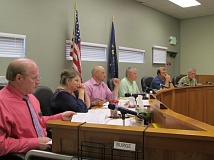 SPOTLIGHT FILE PHOTO - Scappoose city councilors conduct business during a council meeting earlier this year. The council approved an expenditure amount for a settlement agreement with former city manager, Jon Hanken, in early June.