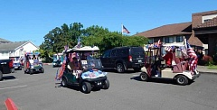 BARBARA SHERMAN - Golf carts decorated patriotically for the annual Fourth of July parade made several passes in front of Pacific Pointe Retirement Inn so the residents could judge them and determine winners.