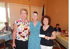 BARBARA SHERMAN - Sandy Brewer (left), Summerfield Women's Golf Club Charity Auction chairwoman, stands with Lori Owen, representing the Caring Closet, and Sara Wade, executive director of the Washington County Domestic Violence Resource Center, following her presentation of a $7,000 check for each organization.