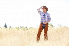 CRAIG MITCHELLDYER/BROADWAY ROSE THEATRE COMPANY - Jared Q. Miller looks right at home on the 'range' as cowboy Curly in the Broadway Rose Theatre Company's production of 'Oklahoma!'