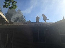 SUBMITTED PHOTO - Firefighters work to put out a fire on Southwest Avalon Drive near Westview High School.