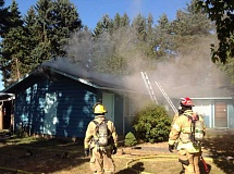 COURTESY PHOTO: FOREST GROVE FIRE & RESCUE - An attic in a duplex on 22nd Avenue in Forest Grove caught fire Thursday but was quickly extinguished by firefighters.