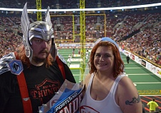 TRIBUNE PHOTO: NATHANAEL MEADOWCROFT - Adrian and Beth Honey spend their wedding 'reception' in the stands at Moda Center, after being married on the field moments before kickoff Saturday night. The couple - who serve as leading members of the Portland Thunder Legion Fan/Booster Club - got to see their team beat the Las Vegas Outlaws 64-33.