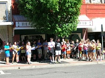 COURTESY PHOTO: JEANNA VANDYKE - The whole cast of 'Bye Bye Birdie' lined up outside on Main Street to sing at the Forest Grove Farmers Market.