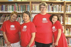 LINDSAY KEEFER - From left, Jan Metzger, Andrea Heid, Josie Hyde and Nicole Scott are among the volunteers who keep the North Marion Community Library running.