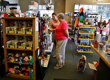 POST PHOTO: KYLIE WRAY - Anna Judd helps a customer at Dollys Pet Shoppe during her 10-year anniversary celebration on Friday, Aug. 7.