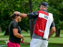 TRIBUNE PHOTO: CHRISTOPHER OERTELL - Ellen Secor gets a congratulatory pat on the head from her caddy and father, Tom Secor, during Tuesday's round in the U.S. Women's Amateur at Portland Golf Club.