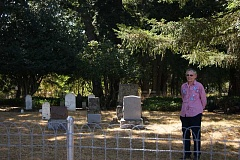 ANGELICA TRUE - Patricia Niday and her family have worked six years to repair tombstones and renovate Molalla's pioneer cemetery, located behind what is now Stoneplace apartments. Now she is fighting to rescue the Heritage Cemetery from the encroachment of further Stoneplace construction along the cemetery fenceline.