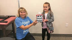 FRIENDS OF THE POOL - Jayden Gattuccio presents her donation of $203.96 to Friends of Molalla Pool board chair, Lucy Allison-Pursley, at the group's July meeting.