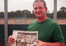 OUTLOOK PHOTO: JOSH KULLA - Dan Hooley holds the 1983 article from the Gresham Outlook detailing Corbett High Schools state championship win in 13 innings over