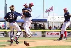 COURTESY: KEN RUMBAUGH - Wilshire-Riverside Little Leaguers head to the mound moments after the team's final victory at a regional tournament in San Bernardino, Calif., on Saturday.