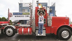 COURTESY PHOTO: WOODBURN DRAGSTRIP - King of the Valley winner Kenny Jones holds aloft his trophy at the Woodburn Dragstrip on Aug. 9.