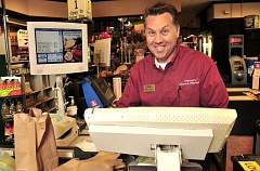 STAFF PHOTO: VERN UYETAKE  - Troy Wolfe, the new store director at Natures Choice Market in Lake Oswego, is eager to get to know the shoppers and get involved with the community.