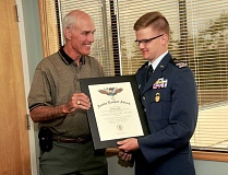 REVIEW PHOTO: VERN UYETAKE - Lake Oswego Mayor Kent Studebaker shakes hands with Civil Air Patrol Cadet Zachary Proffitt, who just achieved the rank of captain, something only about 17,000 people in the nation have done since 1963.