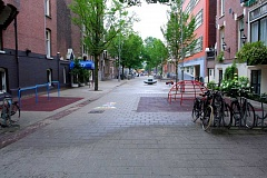 PHOTO: STREETS.MN - A Dutch-style woonerf, with landscaping and streetscape objects to slow cars to walking speeds.