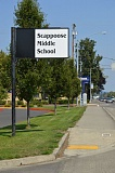 SPOTLIGHT PHOTO: MARK MILLER - A sign along Highway 30 outside Scappoose Middle School previously displayed the school's logo, a stylized 'Warrior' in profile. The icon was taken off the sign during summer maintenance work and is unlikely to be replaced, according to the schools superintendent.