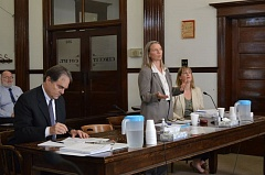 SPOTLIGHT FILE PHOTO - Attorney Gregory Chaimov listens as Ann Kneeland (middle) presents oral arguments in favor of the Columbia County Clerk's approval of a Sustainable Energy Future Ordinance. Last week, a judge ruled in one of two lawsuits regarding the proposed initiative.
