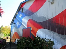 TRIBUNE PHOTO: KEVIN HARDEN - Artist Scott LoBaido chose Post 4248's building to paint an American flag mural during his 50 state tour to paint Old Glory on VFW and American Legion halls across the nation.