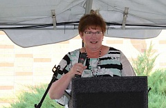 JASON CHANEY - St. Charles Prineville CEO Jeannie Gentry addressses the crowd on Monday evening as one of several guest speakers at the closing ceremony.