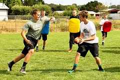 JO WHEAT - North Marion tailback Brian Westman (left) receives a handoff from quarterback Tanner Scanlan.