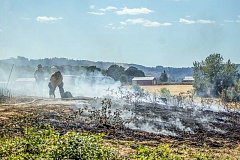 NEWS-TIMES PHOTO: TRAVIS LOOSE - A half-hour after firefighters from Hillsboro Cornelius and Washington County arrived at a Tongue Lane fire Thursday afternoon, it was barely a smoking black patch of dirt.