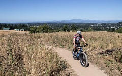 TRIBUNE PHOTO: JONATHAN HOUSE - Jim Berneike bikes up to the Powell Butte Nature Park in East Portland. Its one of the few places to mountain bike inside city limits.