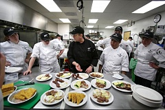 TRIBUNE PHOTO: JONATHAN HOUSE - Oregon Culinary Institute founder Ray Gauthier says Oregon needs to better regulate for-profit schools. Here, OCI instructor Dan Brophy critiques the performance of students during a breakfast prep.