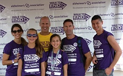 SUBMITTED PHOTO - Tim Sobol (in yellow shirt) with members of his team during last years Walk to End Alzheimers. The Beaverton resident is chairing the Sept. 13 event for the second year.