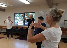 BARBARA SHERMAN - Don Rohrbacher (far left) leads the last tai chi class for the summer at the Tigard Senior Center on Aug. 6, but he is starting a new series in September, and it is not too late to give this slow-movement exercise program a try.