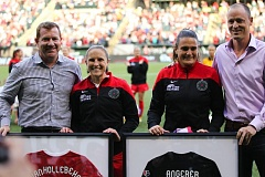 Thorns players Rachel Van Hollebeke (second from left) and Nadine Angerer (second from right) are saluted before Sunday's match and share a photo opportunity with Portland general manager Gavin Wilkinson (left) and Chief Executive Officer Merritt Paulson (right).