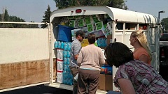 CONTRIBUTED PHOTO - Prineville's AmeriTitle staff load a horse trailer with donations for Canyon Creek fire victims this past Tuesday.