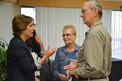 NEWS-TIMES PHOTO: KATHY FULLER - U.S. Rep. Suzanne Bonamici greets citizens during her visit to Centro Cultural in Cornelius Monday evening. Bonamici spent an hour answering questions from constituents.