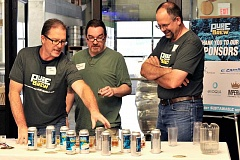 COURTESY PHOTOS - Certified Beer Judges Dave Hayes and Bill Schneller join Clean Water Services board chairman Andy Duyck to select the winners at Saturdays Pure Water Brew competition.