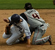 TRIBUNE FILE PHOTO: L.E. BASKOW - In a May 2009 game, Rocky Gale (left) of the Portland Pilots slides into second base as the ball gets caught between his foot and that of Oregon State's John Tommasini.