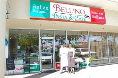 PHOTO BY BETTY CAMPBELL - Benito Omana Moro and his wife, Carina Rodriguez Gutierrez stand in front of their Hillsboro restaurant, Bellino Pasta & Cafe.