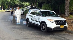 PHOTO COURTESY: CCSO - Clackamas County's Major Crimes Team arrives at Hearthwood Village Mobile Home Park.