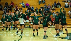 TRIBUNE PHOTO: DIEGO G. DIAZ - The Wilson Trojans celebrate after defeating Lincoln in PIL volleyball.