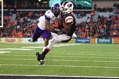 Oregon State's Jordan Villamin hauls in a touchdown reception over Weber State cornerback Devonte Johnson in the Friday night season opener at Reser Stadium.